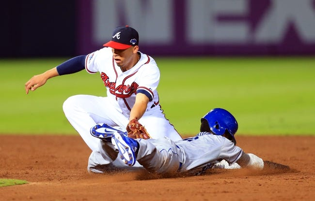Oct 4, 2013; Atlanta, GA, USA; Atlanta Braves shortstop Andrelton Simmons (19) tags out Los Angeles Dodgers shortstop Dee Gordon (9) on a stolen base attempt in the ninth inning of game two of the National League divisional series playoff baseball game at Turner Field. Mandatory Credit: Daniel Shirey-USA TODAY Sports
