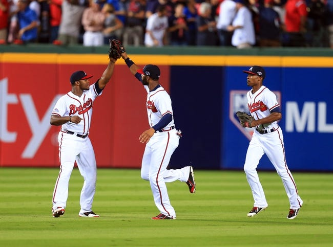 Oct 4, 2013; Atlanta, GA, USA; Atlanta Braves center fielder Jason Heyward (center), right fielder Justin Upton (left), and center fielder B.J. Upton (left) celebrate defeating the Los Angeles Dodgers in game two of the National League divisional series playoff baseball game at Turner Field. The Braves won 4-3. Mandatory Credit: Daniel Shirey-USA TODAY Sports