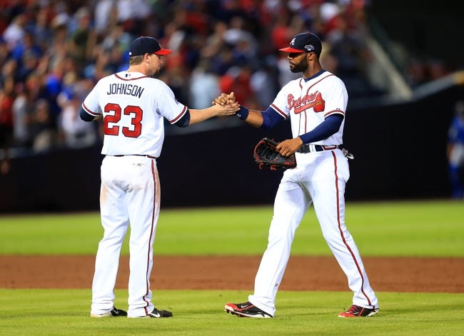 Oct 4, 2013; Atlanta, GA, USA; Atlanta Braves center fielder Jason Heyward (22) celebrates with third baseman Chris Johnson (23) after defeating the Los Angeles Dodgers in game two of the National League divisional series playoff baseball game at Turner Field. The Braves won 4-3. Mandatory Credit: Daniel Shirey-USA TODAY Sports