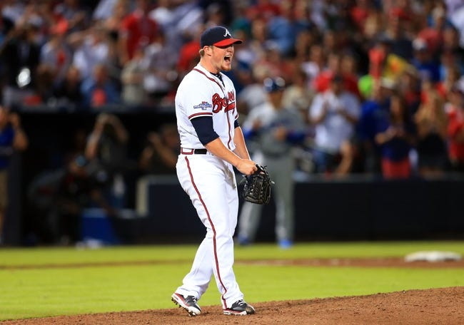 Oct 4, 2013; Atlanta, GA, USA; Atlanta Braves relief pitcher Craig Kimbrel (46) reacts after walking Los Angeles Dodgers center fielder Andre Ethier (not pictured) in the ninth inning of game two of the National League divisional series playoff baseball game at Turner Field. The Braves won 4-3. Mandatory Credit: Daniel Shirey-USA TODAY Sports