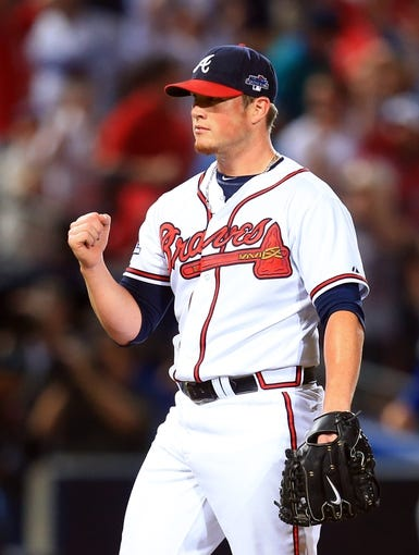 Oct 4, 2013; Atlanta, GA, USA; Atlanta Braves relief pitcher Craig Kimbrel (46) reacts after defeating the Los Angeles Dodgers in game two of the National League divisional series playoff baseball game at Turner Field. The Braves won 4-3. Mandatory Credit: Daniel Shirey-USA TODAY Sports