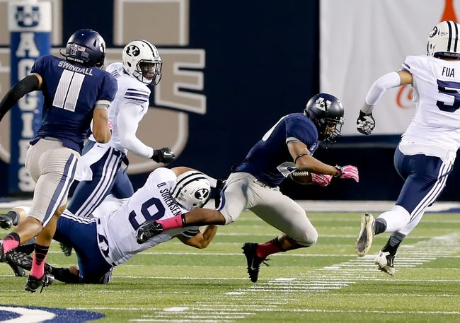 Oct 4, 2013; Logan, UT, USA; Utah State Aggies running back Joey DeMartino (28) is tackled by Brigham Young Cougars defensive back Daniel Sorensen (9) during the second quarter at Romney Stadium. Mandatory Credit: Chris Nicoll-USA TODAY Sports