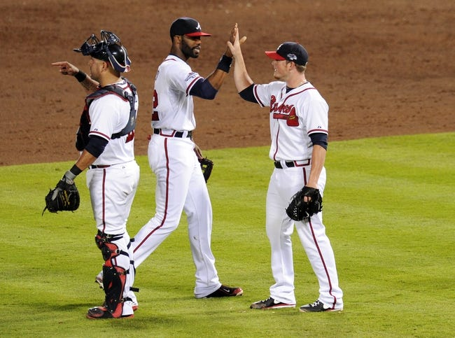 Oct 4, 2013; Atlanta, GA, USA; Atlanta Braves relief pitcher Craig Kimbrel (right) celebrates with center fielder Jason Heyward (left) after defeating the Los Angeles Dodgers in game two of the National League divisional series playoff baseball game at Turner Field. The Braves won 4-3. Mandatory Credit: Dale Zanine-USA TODAY Sports