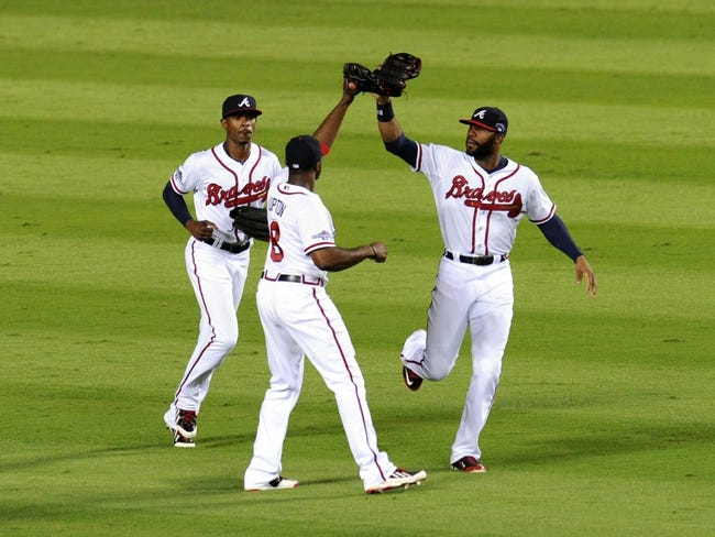 Oct 4, 2013; Atlanta, GA, USA; Atlanta Braves center fielder Jason Heyward (right), right fielder Justin Upton (8), and center fielder B.J. Upton (left) celebrate defeating the Los Angeles Dodgers in game two of the National League divisional series playoff baseball game at Turner Field. The Braves won 4-3. Mandatory Credit: Dale Zanine-USA TODAY Sports