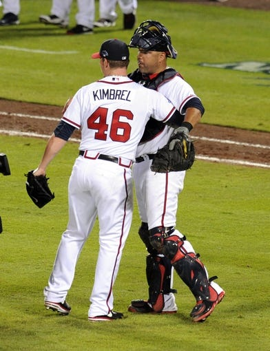 Oct 4, 2013; Atlanta, GA, USA; Atlanta Braves relief pitcher Craig Kimbrel (46) hugs catcher Gerald Laird (11) after defeating the Los Angeles Dodgers in game two of the National League divisional series playoff baseball game at Turner Field. The Braves won 4-3. Mandatory Credit: Dale Zanine-USA TODAY Sports