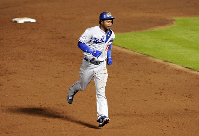 Oct 4, 2013; Atlanta, GA, USA; Los Angeles Dodgers shortstop Hanley Ramirez (13) rounds the bases after hitting a 2-run home run against the Atlanta Braves during the eighth inning of game two of the National League divisional series playoff baseball game at Turner Field. The Braves won 4-3. Mandatory Credit: Dale Zanine-USA TODAY Sports