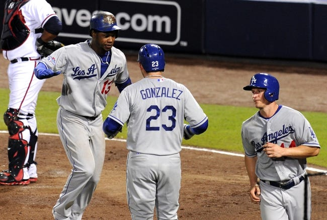 Oct 4, 2013; Atlanta, GA, USA; Los Angeles Dodgers shortstop Hanley Ramirez (13) celebrates with sAtlanta Braves third baseman Chris Johnson (23) after hitting a 2-run home run against the Atlanta Braves during the eighth inning of game two of the National League divisional series playoff baseball game at Turner Field. The Braves won 4-3. Mandatory Credit: Dale Zanine-USA TODAY Sports
