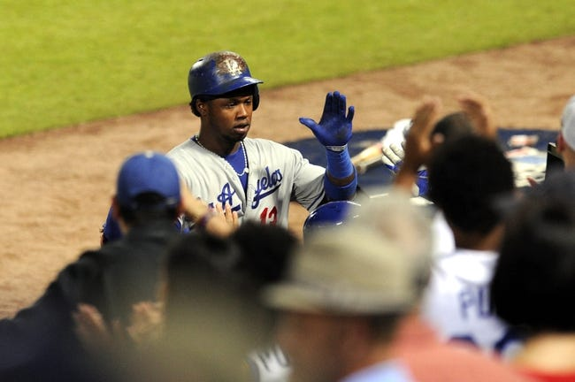 Oct 4, 2013; Atlanta, GA, USA; Los Angeles Dodgers shortstop Hanley Ramirez (13) celebrates after hitting a 2-run home run against the Atlanta Braves during the eighth inning of game two of the National League divisional series playoff baseball game at Turner Field. The Braves won 4-3. Mandatory Credit: Dale Zanine-USA TODAY Sports