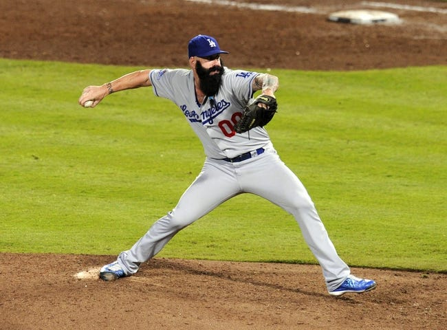 Oct 4, 2013; Atlanta, GA, USA; Los Angeles Dodgers relief pitcher Brian Wilson (00) throws against the Atlanta Braves during the eighth inning of game two of the National League divisional series playoff baseball game at Turner Field. The Braves won 4-3. Mandatory Credit: Dale Zanine-USA TODAY Sports