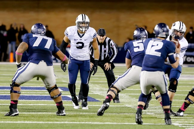 Oct 4, 2013; Logan, UT, USA; Brigham Young Cougars linebacker Kyle Van Noy (3) watches Utah State Aggies quarterback Craig Harrison (12) during the second half at Romney Stadium. BYU won 31-14. Mandatory Credit: Chris Nicoll-USA TODAY Sports