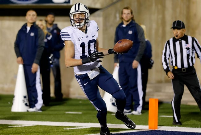 Oct 4, 2013; Logan, UT, USA; Brigham Young Cougars wide receiver Mitch Mathews (10) catches a pass and scores a touchdown against the Utah State Aggies during the third quarter at Romney Stadium. BYU won 31-14. Mandatory Credit: Chris Nicoll-USA TODAY Sports