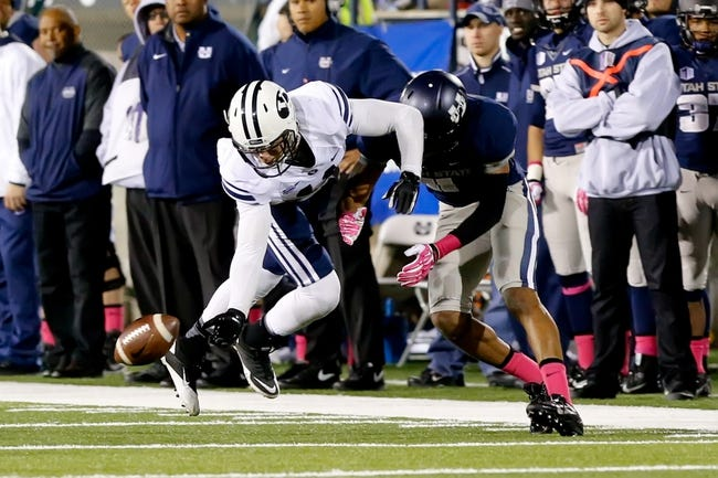 Oct 4, 2013; Logan, UT, USA; Brigham Young Cougars defensive back Dallin Leavitt (11) breaks up a pass to Utah State Aggies wide receiver Brandon Swindall (11) during the third quarter at Romney Stadium. BYU won 31-14. Mandatory Credit: Chris Nicoll-USA TODAY Sports