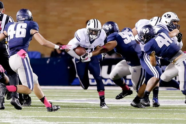Oct 4, 2013; Logan, UT, USA; Brigham Young Cougars running back Jamaal Williams (21) runs against the Utah State Aggies defensive during the fourth quarter at Romney Stadium. BYU won 31-14. Mandatory Credit: Chris Nicoll-USA TODAY Sports
