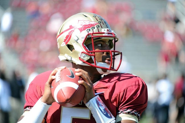 Oct 5, 2013; Tallahassee, FL, USA; Florida State Seminoles quarterback Jameis Winston (5) warms up before the start of the game against the Maryland Terrapins at Doak Campbell Stadium. Mandatory Credit: Melina Vastola-USA TODAY Sports