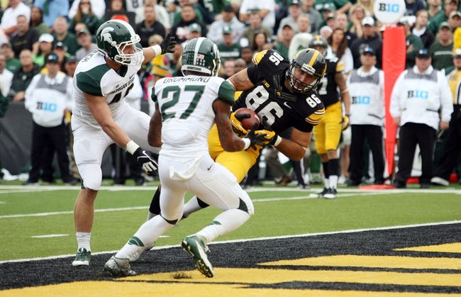 Oct 5, 2013; Iowa City, IA, USA;  Michigan State Spartans linebacker Max Bullough (40) and safety Kurtis Drummond (27) watch as Iowa Hawkeyes tight end C. J. Fiedorowicz (86) scores a touchdown at Kinnick Stadium. Mandatory Credit: Reese Strickland-USA TODAY Sports