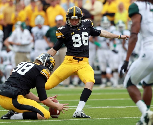 Oct 5, 2013; Iowa City, IA, USA;  Iowa Hawkeyes kicker Mike Meyers (96) kicks the extra point against the Michigan State Spartans at Kinnick Stadium. Mandatory Credit: Reese Strickland-USA TODAY Sports