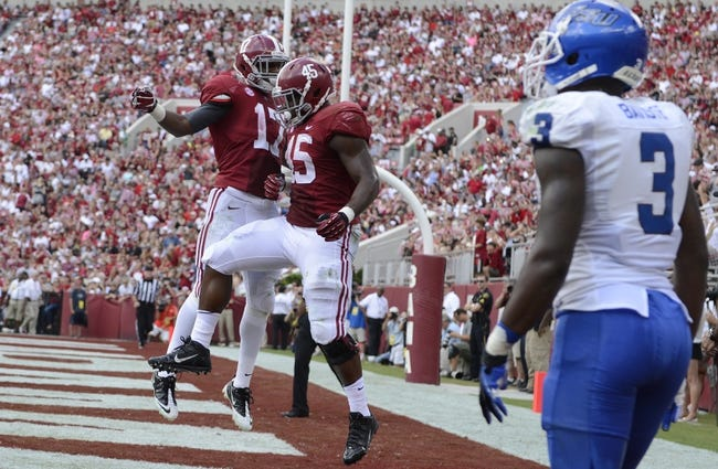 Oct 5, 2013; Tuscaloosa, AL, USA; Alabama Crimson Tide running back Jalston Fowler (45) celebrates his touchdown with running back Kenyan Drake (17) in the end zone against the Georgia State Panthers during the second quarter at Bryant-Denny Stadium. Mandatory Credit: John David Mercer-USA TODAY Sports
