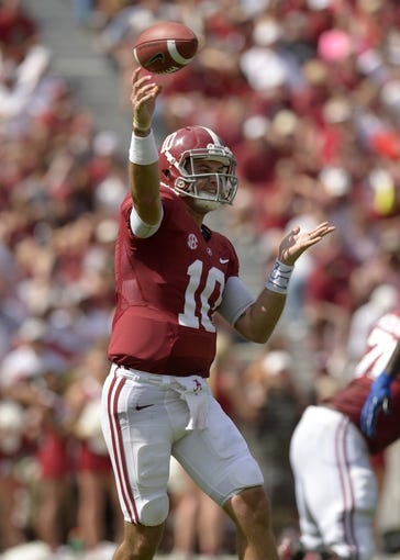 Oct 5, 2013; Tuscaloosa, AL, USA; Alabama Crimson Tide quarterback A.J. McCarron (10) passes against the Georgia State Panthers during the second quarter at Bryant-Denny Stadium. Mandatory Credit: John David Mercer-USA TODAY Sports