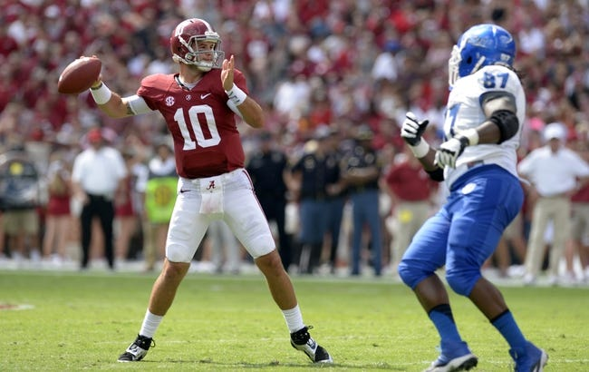 Oct 5, 2013; Tuscaloosa, AL, USA; Alabama Crimson Tide quarterback A.J. McCarron (10) drops back to pass against the Georgia State Panthers during the second quarter at Bryant-Denny Stadium. Mandatory Credit: John David Mercer-USA TODAY Sports