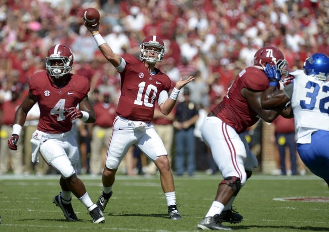Oct 5, 2013; Tuscaloosa, AL, USA; Alabama Crimson Tide quarterback A.J. McCarron (10) throws a pass against the Georgia State Panthers during the first quarter at Bryant-Denny Stadium. Mandatory Credit: John David Mercer-USA TODAY Sports