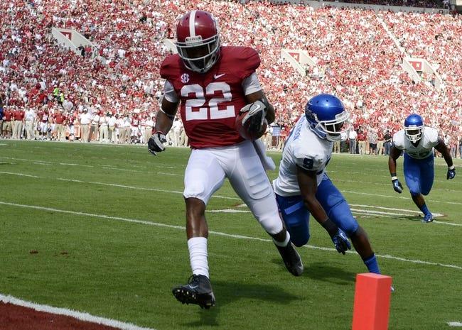 Oct 5, 2013; Tuscaloosa, AL, USA; Alabama Crimson Tide wide receiver Christion Jones (22) scores a touchdown past Georgia State Panthers cornerback Brent McClendon (9) during the first quarter at Bryant-Denny Stadium. Mandatory Credit: John David Mercer-USA TODAY Sports