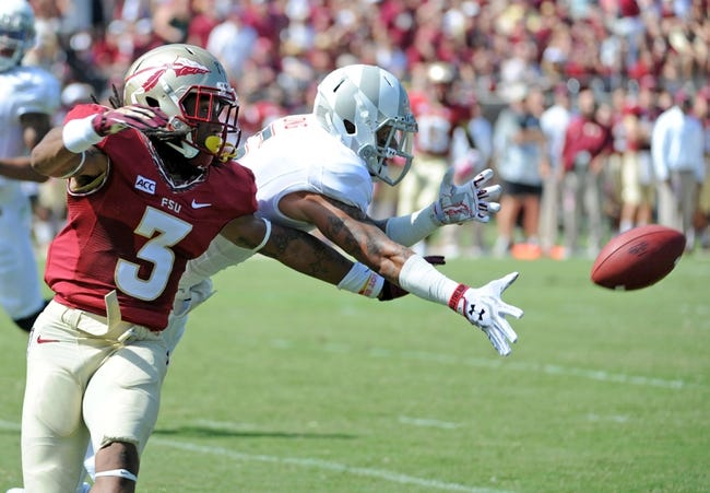 Oct 5, 2013; Tallahassee, FL, USA; Maryland Terrapins wide receiver Deon Long (6) is unable to catch a pass against Florida State Seminoles defensive back Ronald Darby (3) during the first quarter of the game at Doak Campbell Stadium. Mandatory Credit: Melina Vastola-USA TODAY Sports
