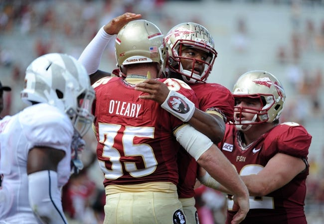 Oct 5, 2013; Tallahassee, FL, USA; Florida State Seminoles quarterback Jameis Winston (5) celebrates with tight end Nick O'Leary (35) after throwing a touchdown pass during the second half of the game against the Maryland Terrapins at Doak Campbell Stadium. Mandatory Credit: Melina Vastola-USA TODAY Sports