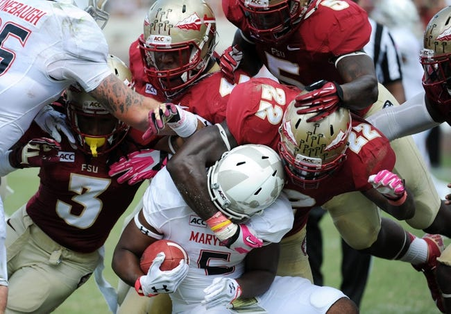 Oct 5, 2013; Tallahassee, FL, USA; Maryland Terrapins running back Albert Reid (5) is tackled by Florida State Seminoles linebacker Telvin Smith (22) during the second half of the game at Doak Campbell Stadium. Mandatory Credit: Melina Vastola-USA TODAY Sports