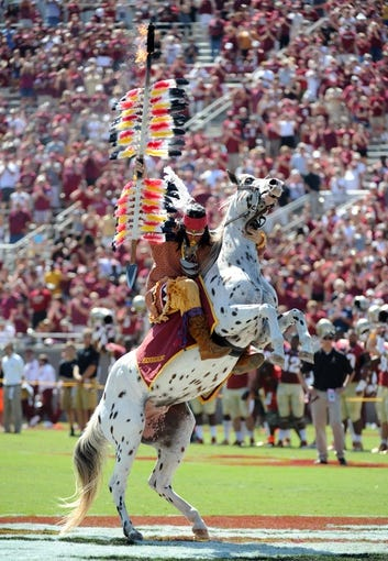 Oct 5, 2013; Tallahassee, FL, USA; Florida State Seminoles mascot Chief Osceola spikes the spear before the start of the game against the Maryland Terrapins at Doak Campbell Stadium. Mandatory Credit: Melina Vastola-USA TODAY Sports