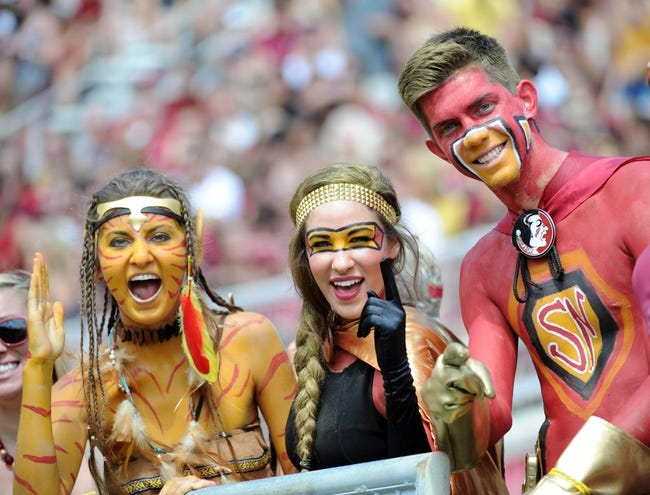 Oct 5, 2013; Tallahassee, FL, USA; Florida State Seminoles fans cheer on their team during the game against the Maryland Terrapins at Doak Campbell Stadium. Mandatory Credit: Melina Vastola-USA TODAY Sports