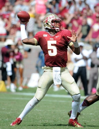 Oct 5, 2013; Tallahassee, FL, USA; Florida State Seminoles quarterback Jameis Winston (5) throws a pass during the game against the Maryland Terrapins at Doak Campbell Stadium. Mandatory Credit: Melina Vastola-USA TODAY Sports
