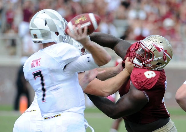 Oct 5, 2013; Tallahassee, FL, USA; Florida State Seminoles defensive tackle Timmy Jernigan (8) puts pressure on Maryland Terrapins quarterback Caleb Rowe (7) during the second half of the game at Doak Campbell Stadium. Mandatory Credit: Melina Vastola-USA TODAY Sports