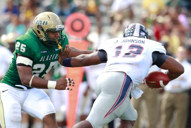 Oct 5, 2013; Birmingham, AL, USA; UAB Blazers linebacker Destin Challenger (25) reaches for Florida Atlantic Owls quarterback Jaquez Johnson (12)  at Legion Field. Mandatory Credit: Marvin Gentry-USA TODAY Sports
