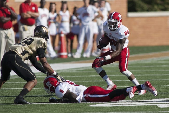 Oct 5, 2013; Winston-Salem, NC, USA; North Carolina State Wolfpack wide receiver Bryan Underwood (80) runs the ball after making a catch during the second quarter against the Wake Forest Demon Deacons at BB&T Field. Mandatory Credit: Jeremy Brevard-USA TODAY Sports