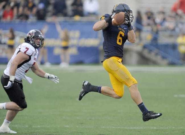 Oct 5, 2013; Kent, OH, USA; Kent State Golden Flashes wide receiver Chris Humphrey (6) makes a catch as Northern Illinois Huskies linebacker Michael Santacaterina (7) defends during the third quarter at Dix Stadium. Northern Illinois beat Kent State 38-24. Mandatory Credit: Ken Blaze-USA TODAY Sports