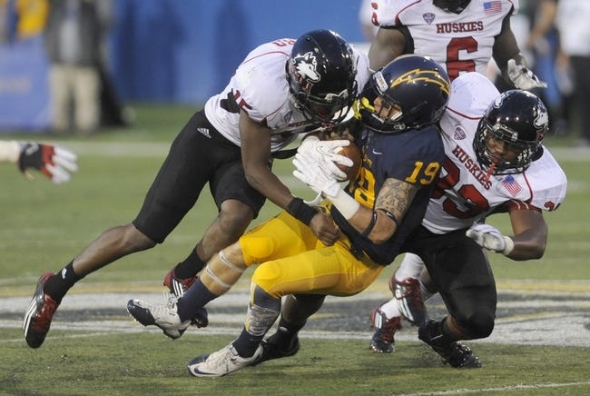 Oct 5, 2013; Kent, OH, USA; Kent State Golden Flashes wide receiver Josh Boyle (19) is tackled by Northern Illinois Huskies linebacker Jamaal Payton (33) and Northern Illinois Huskies safety Jimmie Ward (15)  during the fourth quarter at Dix Stadium. Northern Illinois beat Kent State 38-24. Mandatory Credit: Ken Blaze-USA TODAY Sports
