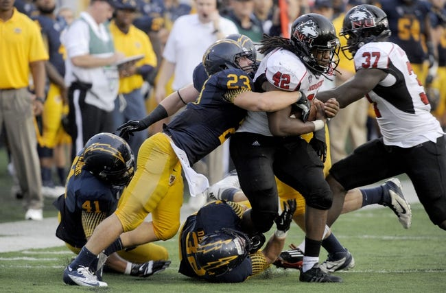 Oct 5, 2013; Kent, OH, USA; Northern Illinois Huskies running back Cameron Stingily (42) is taken down by Kent State Golden Flashes safety Jordan Italiano (23) and Kent State Golden Flashes linebacker Matt Dellinger (32) during the fourth quarter at Dix Stadium. Northern Illinois beat Kent State 38-24. Mandatory Credit: Ken Blaze-USA TODAY Sports