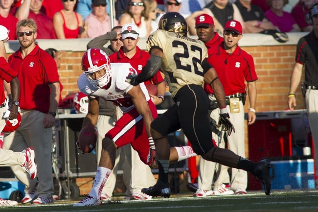 Oct 5, 2013; Winston-Salem, NC, USA; North Carolina State Wolfpack wide receiver Quintin Payton (88) runs after making a catch during the third quarter against the Wake Forest Demon Deacons at BB&T Field. Wake defeated North Carolina State 28-13. Mandatory Credit: Jeremy Brevard-USA TODAY Sports