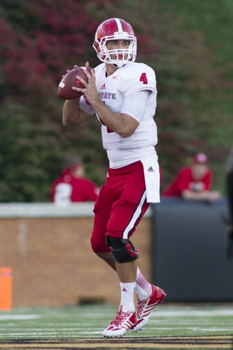 Oct 5, 2013; Winston-Salem, NC, USA; North Carolina State Wolfpack quarterback Pete Thomas (4) looks to pass the ball during the fourth quarter against the Wake Forest Demon Deacons at BB&T Field. Wake defeated North Carolina State 28-13. Mandatory Credit: Jeremy Brevard-USA TODAY Sports