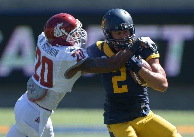 Oct 5, 2013; Berkeley, CA, USA; Washington State Cougars safety Deone Buccanon (20) tackles California Golden Bears running back Daniel Lasco (2) at Memorial Stadium. Washington State defeated California 44-22. Mandatory Credit: Kirby Lee-USA TODAY Sports
