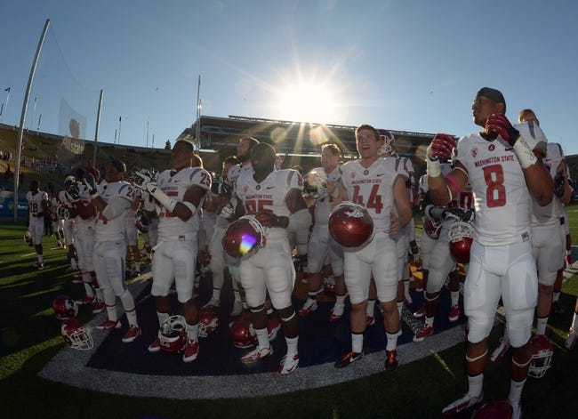 Oct 5, 2013; Berkeley, CA, USA; Washington State Cougars players Theron West (24), Daquawn Brown (25), John Thompson (85), Wes Concepcion (44) and Jeremiah Allison (8) celebrate at the end of the game against the California Golden Bears at Memorial Stadium. Washington State defeated California 44-22. Mandatory Credit: Kirby Lee-USA TODAY Sports