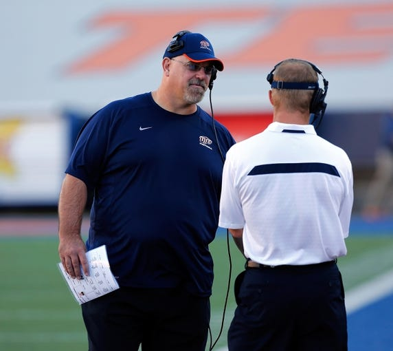 Oct 5, 2013; El Paso, TX, USA; UTEP head coach Sean Kugler speaks to one of his assistant coaches as the Miners face the Louisiana Tech Bulldogs at Sun Bowl Stadium. Mandatory Credit: Ivan Pierre Aguirre-USA TODAY Sports