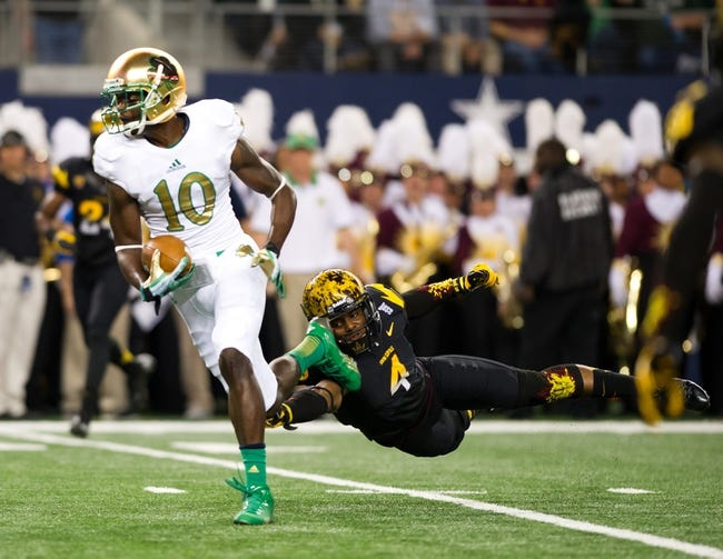 Oct 5, 2013; Arlington, TX, USA; Arizona State Sun Devils safety Alden Darby (4) attempts to tackle Notre Dame Fighting Irish wide receiver DaVaris Daniels (10) in the second quarter at AT&T Stadium. Mandatory Credit: Matt Cashore-USA TODAY Sports