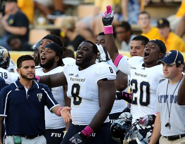Oct 5, 2013; Hattiesburg, MS, USA; Fiu Golden Panthers including defensive tackle Greg Hickman (8) and cornerback Brad Hyman-Muhammad (20) celebrate on the bench in the fourth quarter of their game against the Southern Miss Golden Eagles at M.M. Roberts Stadium. FIU won 24-23. Mandatory Credit: Chuck Cook-USA TODAY Sports
