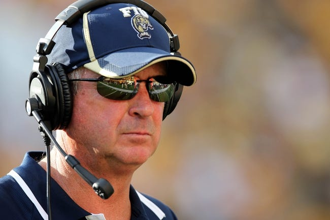 Oct 5, 2013; Hattiesburg, MS, USA; FIU Golden Panthers head coach Ron Turner watches their game against the Southern Miss Golden Eagles from the bench during the second half at M.M. Roberts Stadium. FIU won 24-23. Mandatory Credit: Chuck Cook-USA TODAY Sports