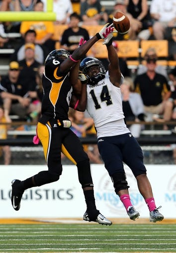 Oct 5, 2013; Hattiesburg, MS, USA; Fiu Golden Panthers safety Demarkus Perkins (14) knocks a pass away from Southern Miss Golden Eagles wide receiver Marquise Ricard (6) during the second half at M.M. Roberts Stadium. FIU won 24-23. Mandatory Credit: Chuck Cook-USA TODAY Sports