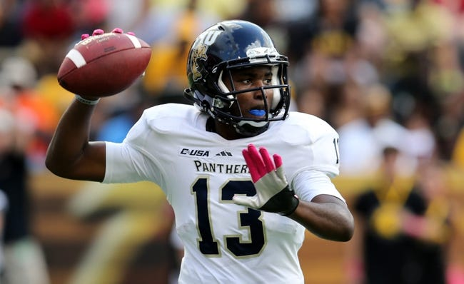 Oct 5, 2013; Hattiesburg, MS, USA; FIU Golden Panthers quarterback E.J. Hilliard (13) looks to throw a pass against the Southern Miss Golden Eagles during the second half at M.M. Roberts Stadium. FIU won 24-23. Mandatory Credit: Chuck Cook-USA TODAY Sports