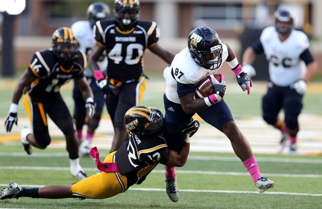 Oct 5, 2013; Hattiesburg, MS, USA; FIU Golden Panthers tight end Jonnu Smith (87) runs after a catch while dragging Southern Miss Golden Eagles defensive back Emmanuel Johnson (12) during the second half at M.M. Roberts Stadium. FIU won 24-23. Mandatory Credit: Chuck Cook-USA TODAY Sports