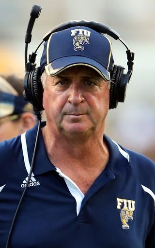 Oct 5, 2013; Hattiesburg, MS, USA; FIU Golden Panthers head coach Ron Turner on the bench during the second half of their game against the Southern Miss Golden Eagles at M.M. Roberts Stadium. FIU won 24-23. Mandatory Credit: Chuck Cook-USA TODAY Sports