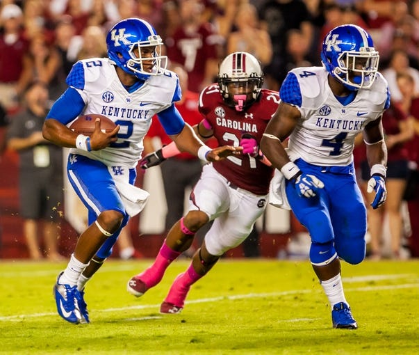 Oct 5, 2013; Columbia, SC, USA; Kentucky Wildcats quarterback Jalen Whitlow (2) scrambles against the South Carolina Gamecocks in the second quarter at Williams-Brice Stadium. Mandatory Credit: Jeff Blake-USA TODAY Sports